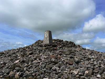 The top of Windy Gyle is marked by a large Bronze Age burial cairn