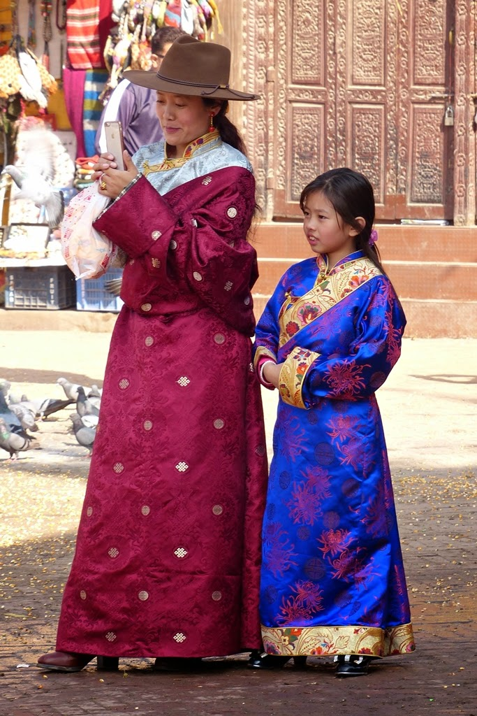 Mother and daughter in traditional Tibetan dress