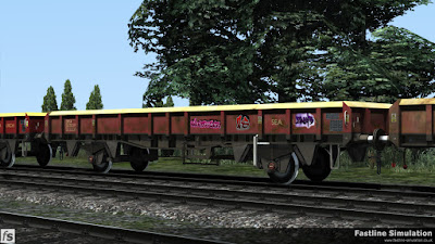 Fastline Simulation - ZCA Sea Urchin ex VDA [EWS]: A ZCA Sea Urchin converted from a lot 3908 VDA van is seen in a rake of similar wagons. The wagon appears to have been 'tagged' at some point and fiffering levels of weathering are evident when comparing the three wagons that can be seen.