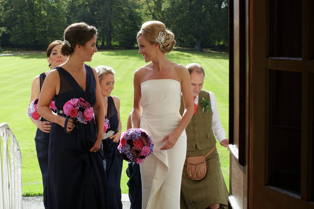 bride chose a simple and elegant dress so a hairstyle with volume and soft texture worked best