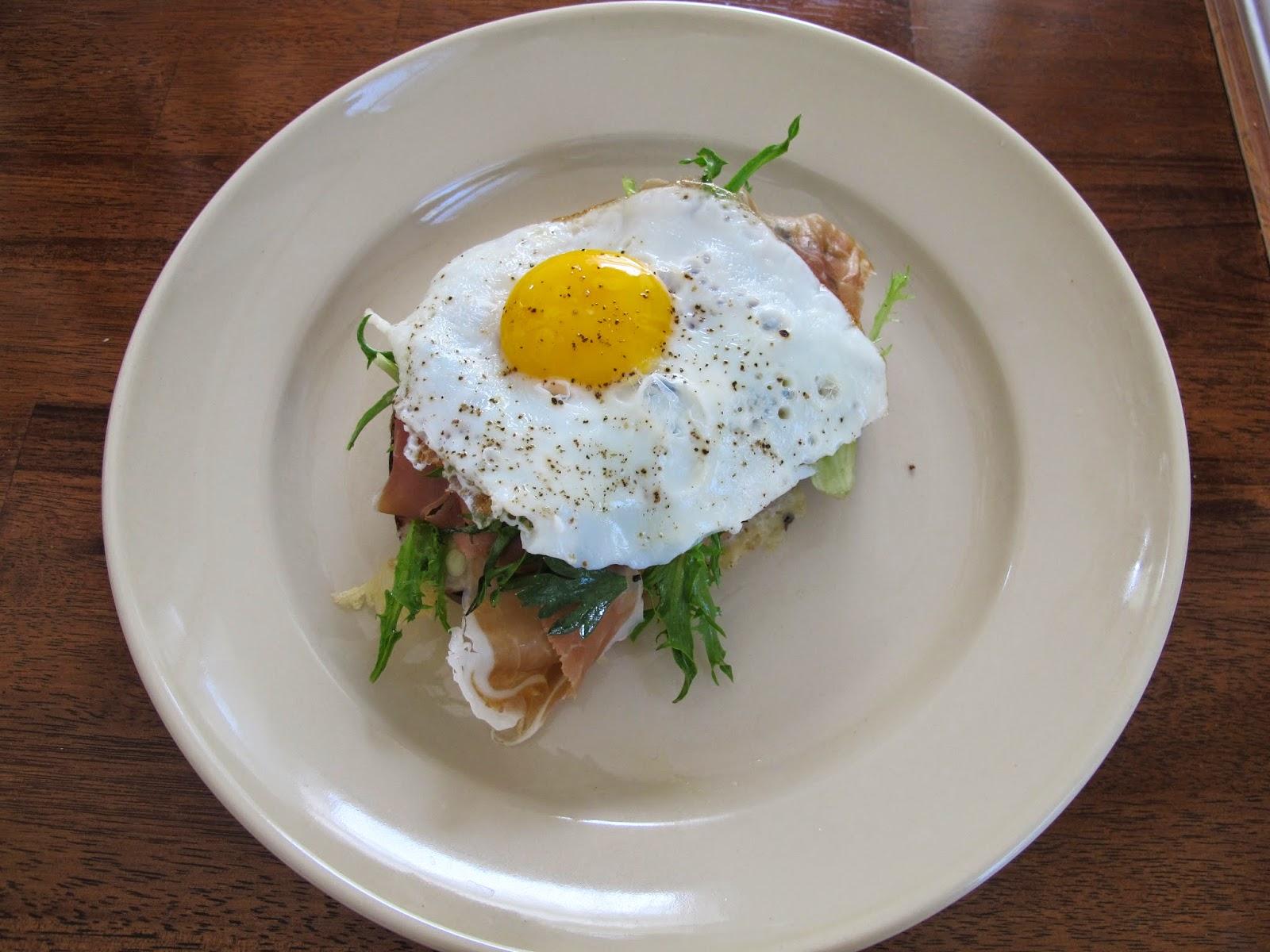 Brioche with Gruyere, Prosciutto, Frisee, and Fried Egg