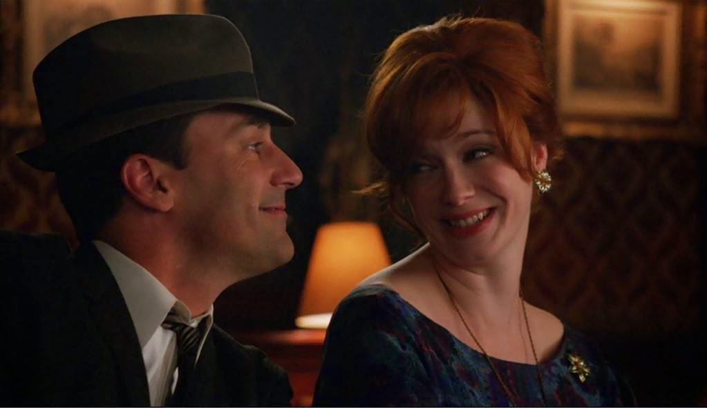 Don Draper asks Joan Holloway Harris to dance with him