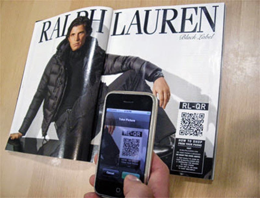 Ralph Lauren magazine ad with smartphone scanning QR code on page.
