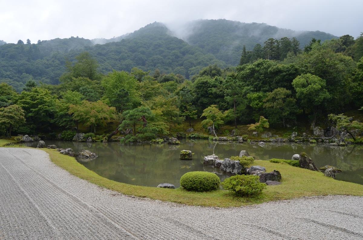Garden At Tenryu Ji Monastery, Kyoto. Classic Sand Garden, Pool And  Borrowed Scenery.
