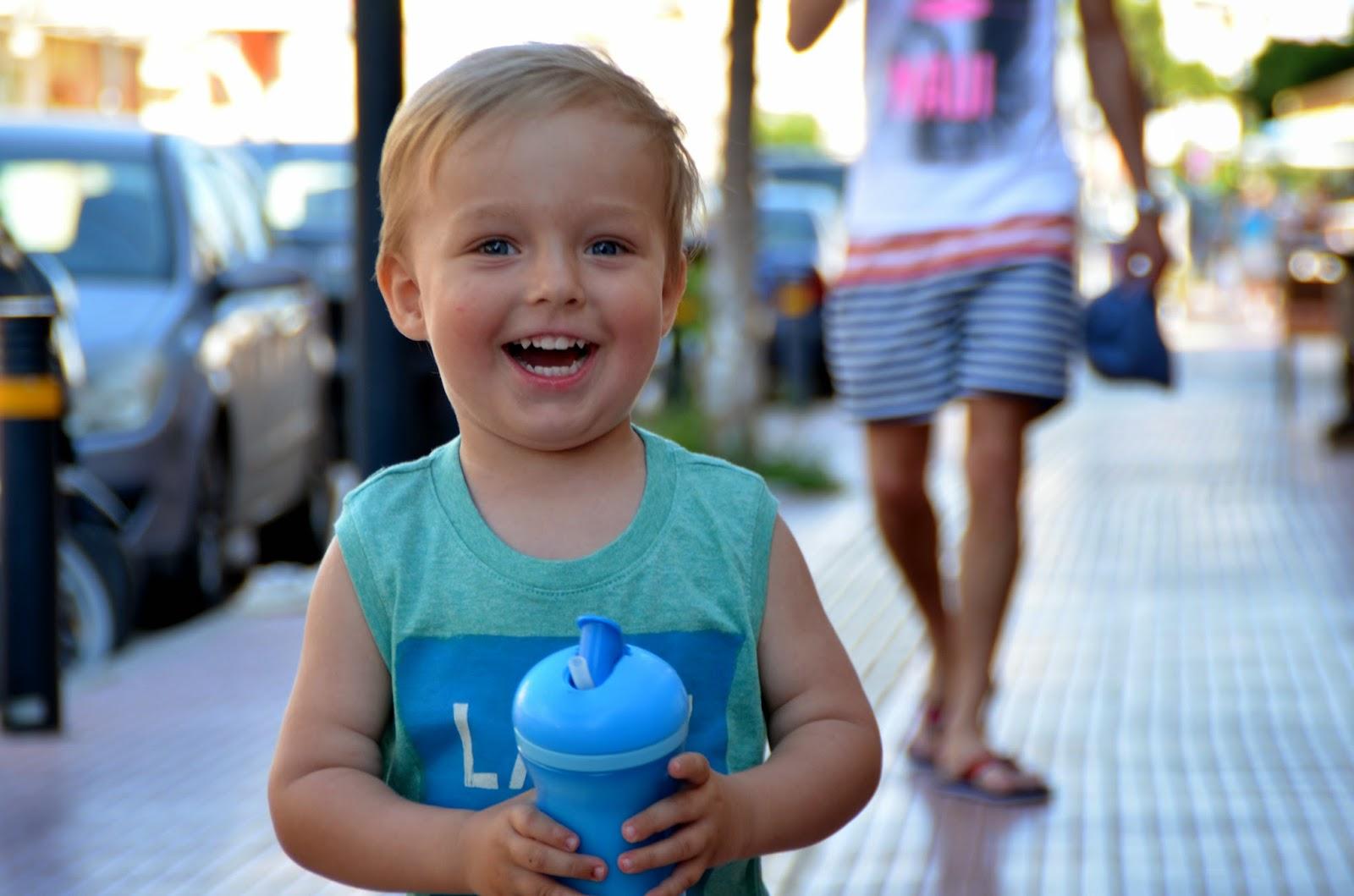 blond toddler tank top orange shorts crete
