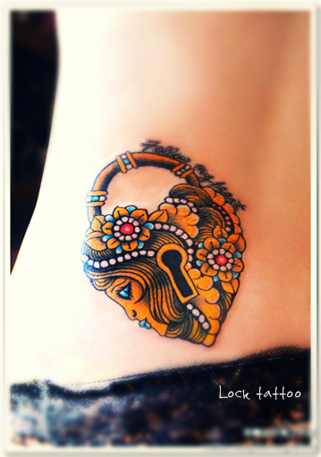 a lock tattoo on the hip with Egyptian style of decoration