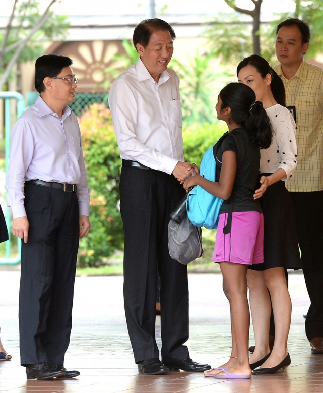 Deputy Prime Minister Teo Chee Hean and Education Minister Heng Swee Keat speaking with  the parents and students during the reunion in the TKPS school.