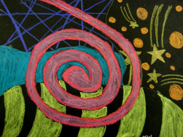 Student artwork using black paper and construction paper crayons