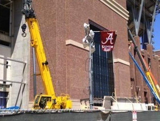 Crane operator alledegly fired for flying Alabama flag on construction site at Texas A M's Kyle Field.