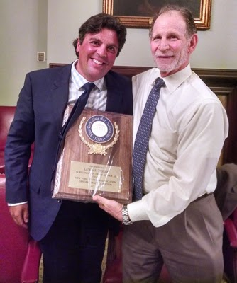 Richard A. Klass (l) presents award to Lew Tesser for service to the New York State Bar Association.