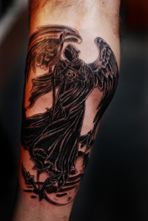 Grim Reaper / Angel of Death tattoo: winged angel of death wearing a hooded black cloak