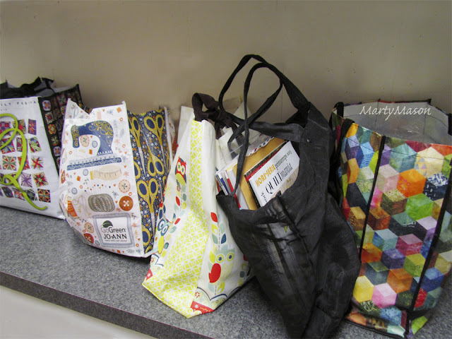 bags filled with fabric loot from Houston Quilt Festival 2015
