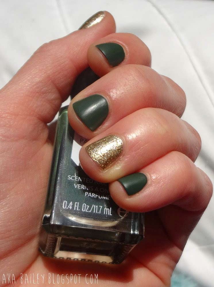 Gold glitter accent nails with matte emerald green nails for St. Patrick's Day