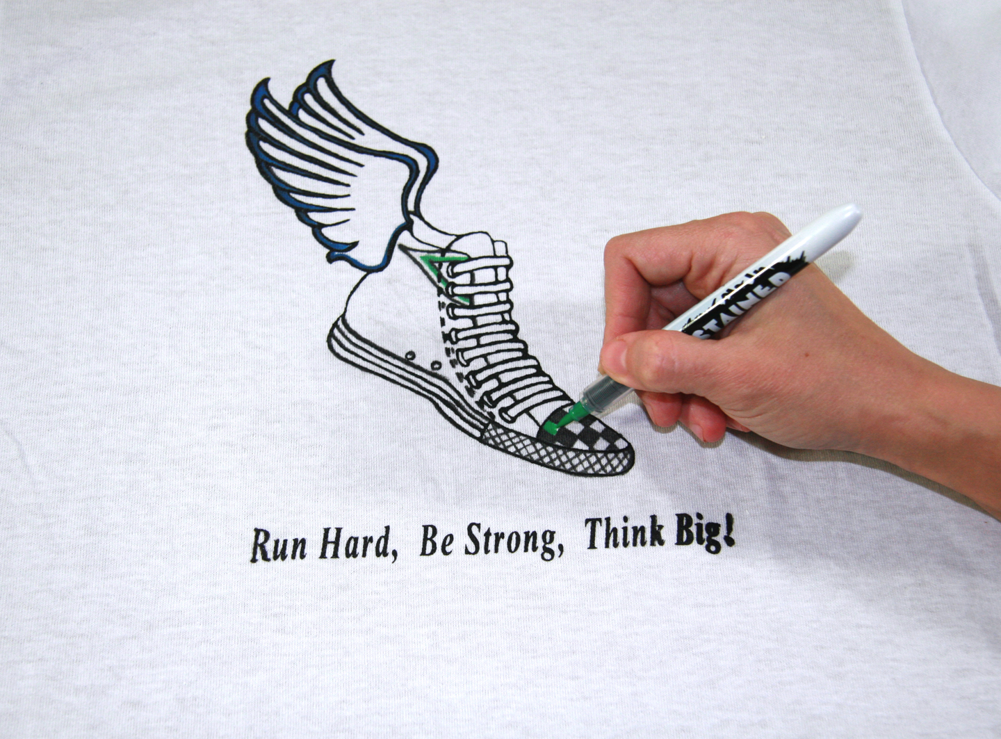 Fill the colors in the printed desing on t-shirt by using Stained By Sharpie fabric markers