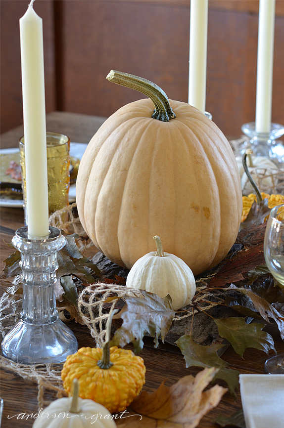 Large yellow pumpkin as centerpiece for Thanksgiving table | www.andersonandgrant.com