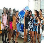 NNSM 2010 Contestants posing beside RED BULL CAR.