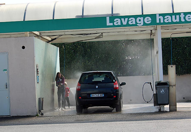 car wash with woman washing her car