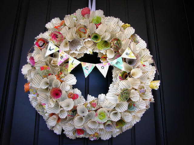 http://www.cornerhouseblog.com/2011/07/awesome-paper-cone-wreath-tutorial.html