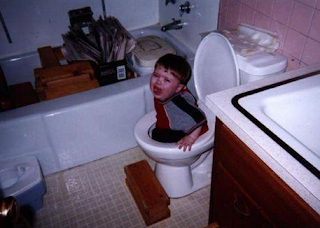 funny pics: child stuck in toilet bowl