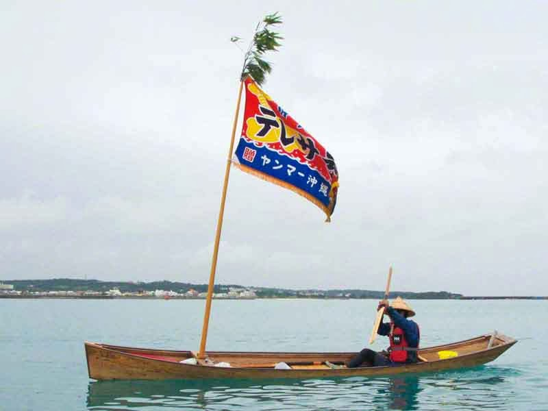 one man sailing sabani boat