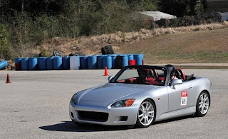 Racing around a course in my two seat convertible.