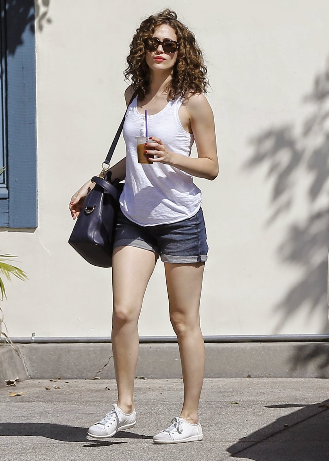 Emmy Rossum shows off legs in denim shorts out in Beverly Hills