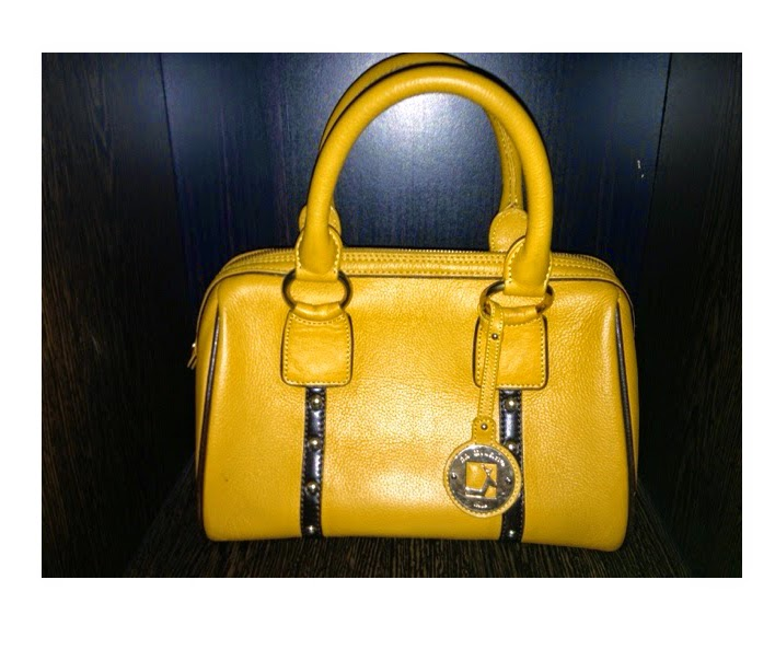 yellow da Milano bag.
