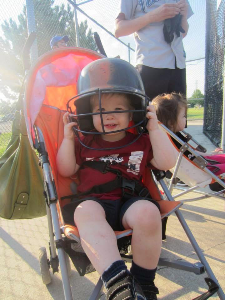 toddler at the batting cages Centennial Park Toronto