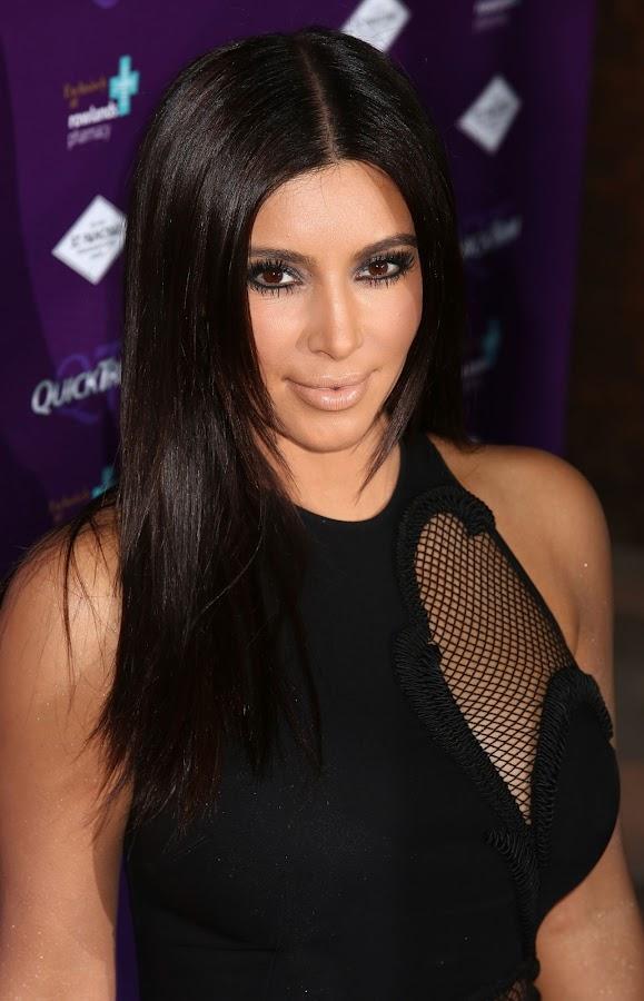 Kim Kardashian in a black dress with cutaway mesh panels