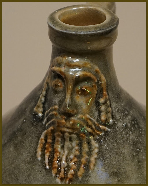 Closeup of pottery Bartmann or Bellarmine jug (replica) by Lily L.