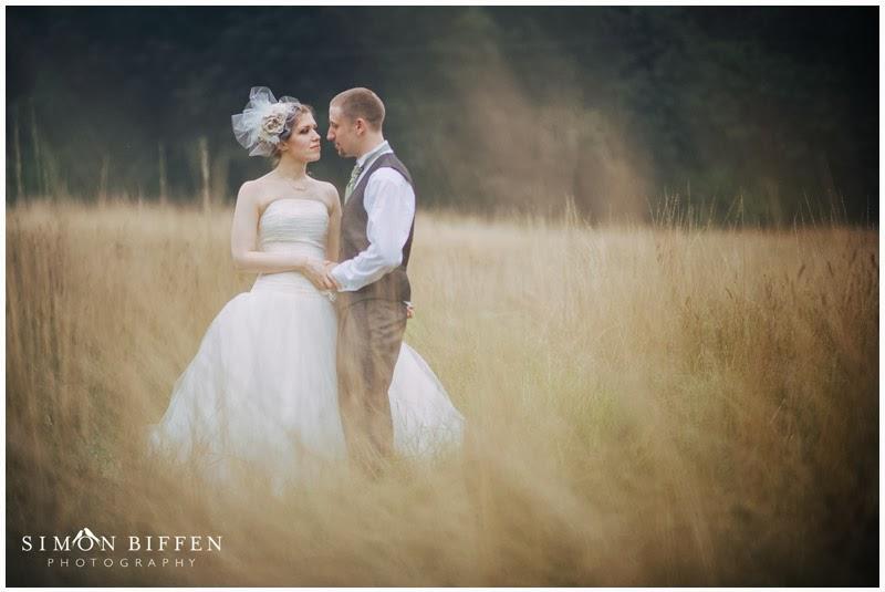 Bride and Groom in a meadow Blackthorpe Barn