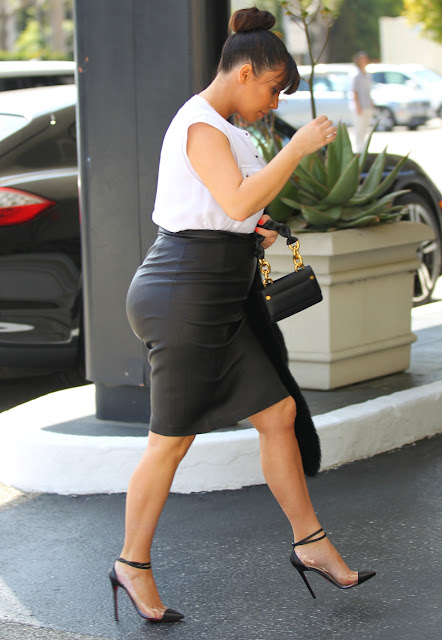 Kim Kardashian wears a leather maternity skirt