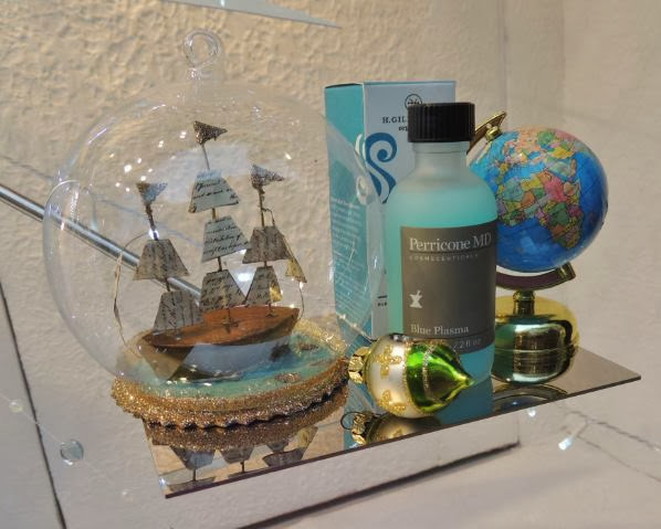 Globe, ship in a bottle and toiletries in Christmas 2013 display
