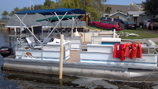 pontoon boat sitting in dock