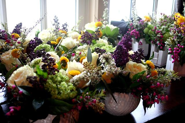 Isha Foss Events Spring centerpieces lilac, baronia, lisianthus, viburnum