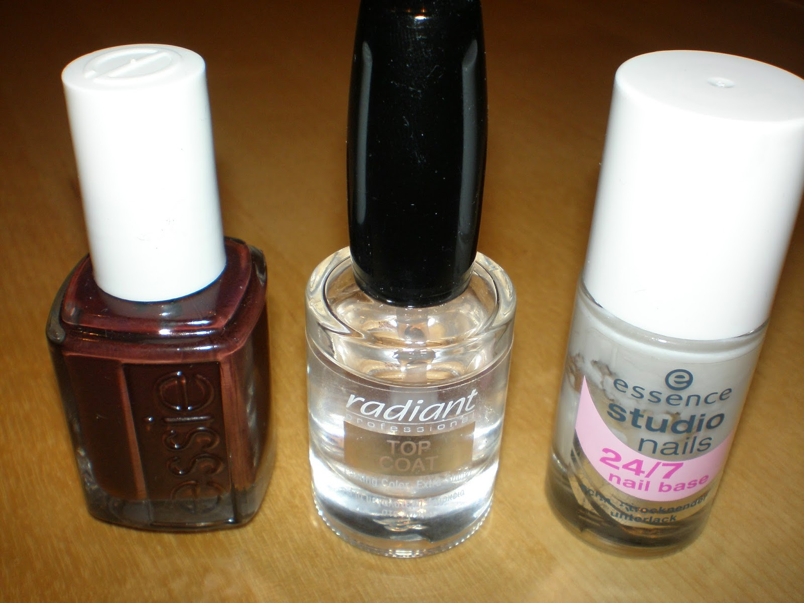 A DIY manicure at home with Essence nail base, Radiant top coat and Essie nail polish in Lady Godiva