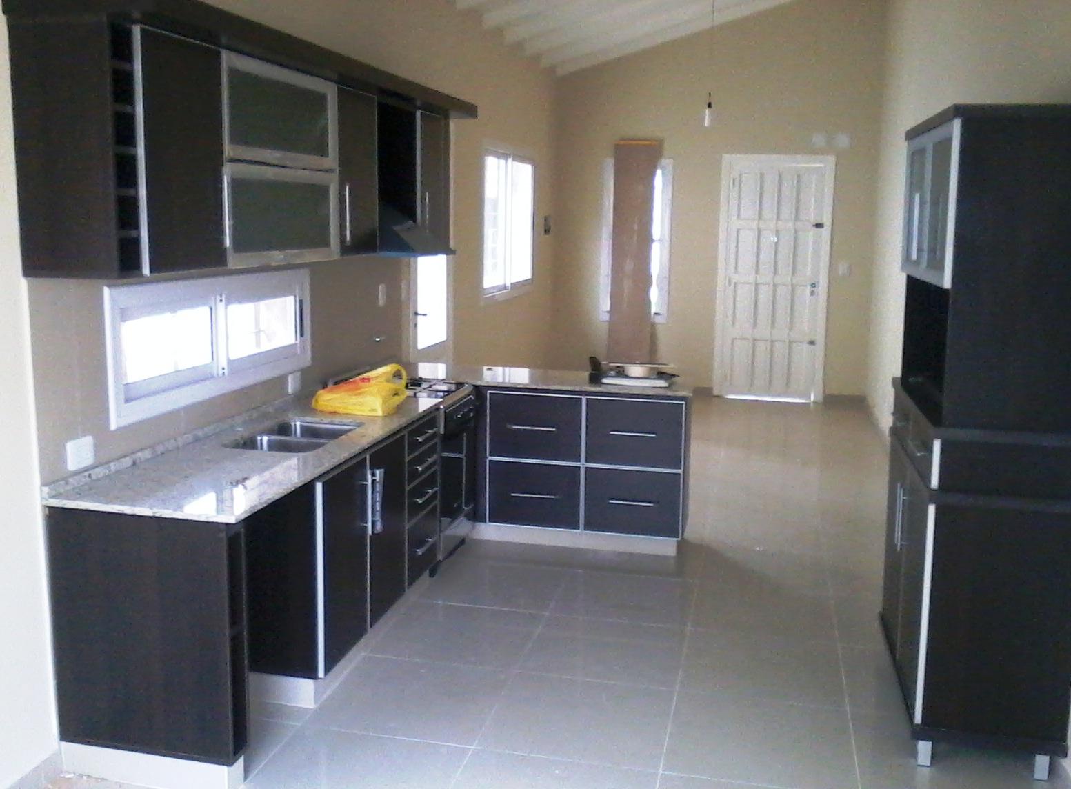 Reynaga muebles mueble de cocina a medida en wengue con - Muebles de cocina hechos de obra ...
