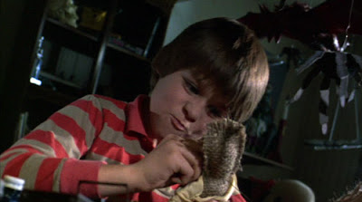 A kid killing his father with a voodoo doll in Creepshow