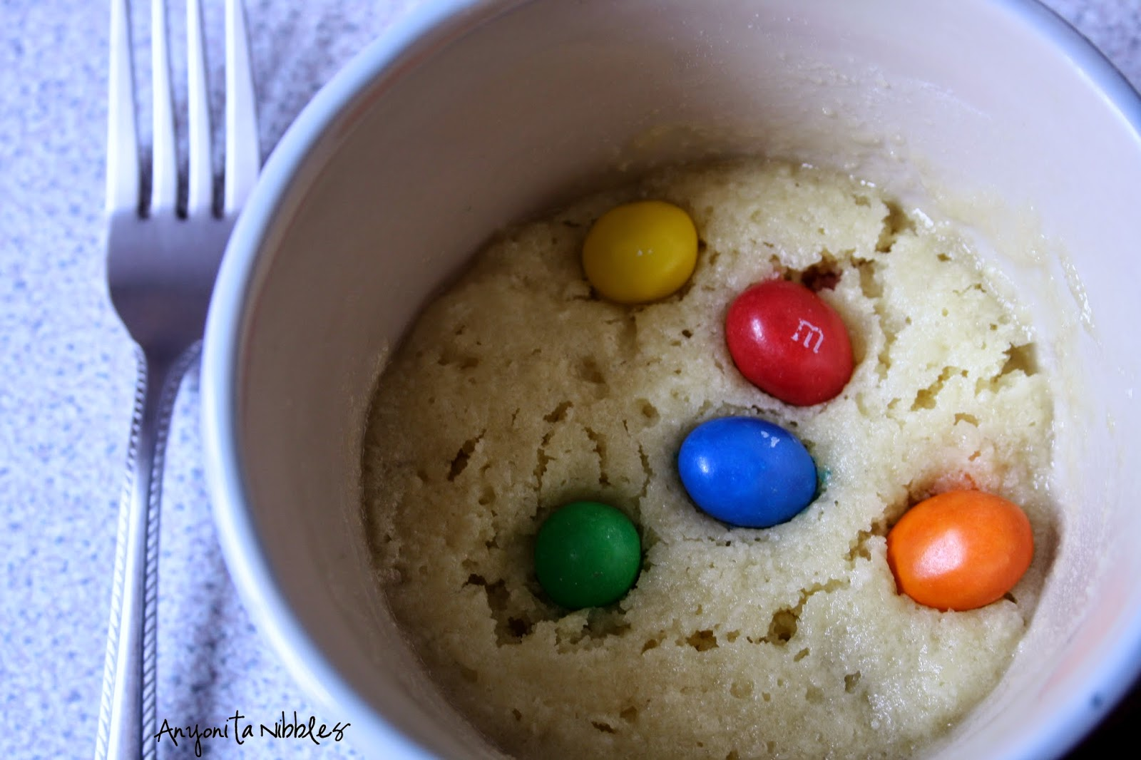 A gluten free mug cookie with m&ms from Anyonita Nibbles