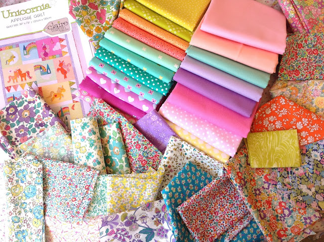 Collection of Liberty Fabric and Kona Cotton for Unicornia Quilt