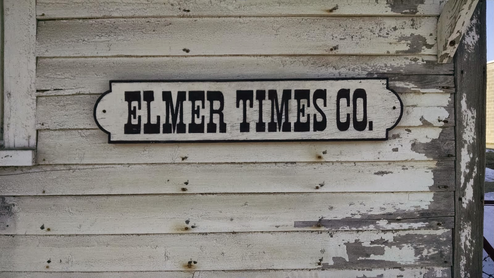 Elmer Times Company sign