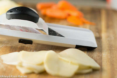 OXO's Hand-Held Mandolin Slicer with sliced potatoes and carrots--Pescetarian Journal