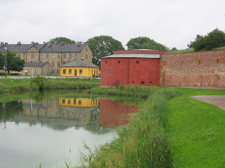company building protective wall or moat
