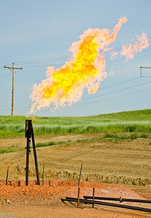 A natural gas flare on a family farm in North Dakota. (Credit: Tim Evanson / Flickr) Click to enlarge.