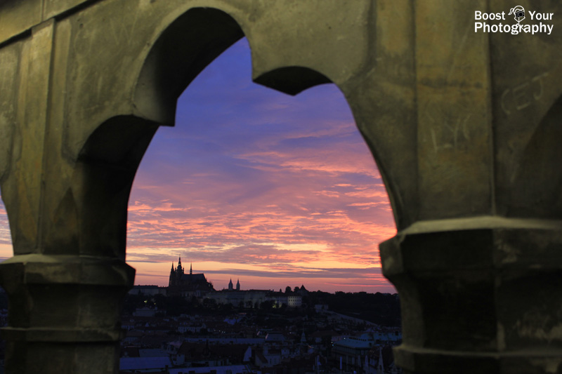 sunset over prague castle framed by the astronomical tower boost your photography