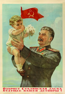 USSR propaganda poster of Stalin holding a happy kid