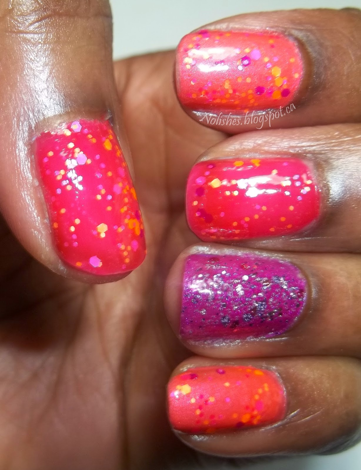 Skittles manicure with purple, fuchsia, and coral polishes covered in a purple, fuchsia,and orange glitter. Accent nail is covered with a traditional metallic glitter with lilac, pink, and plum tones.