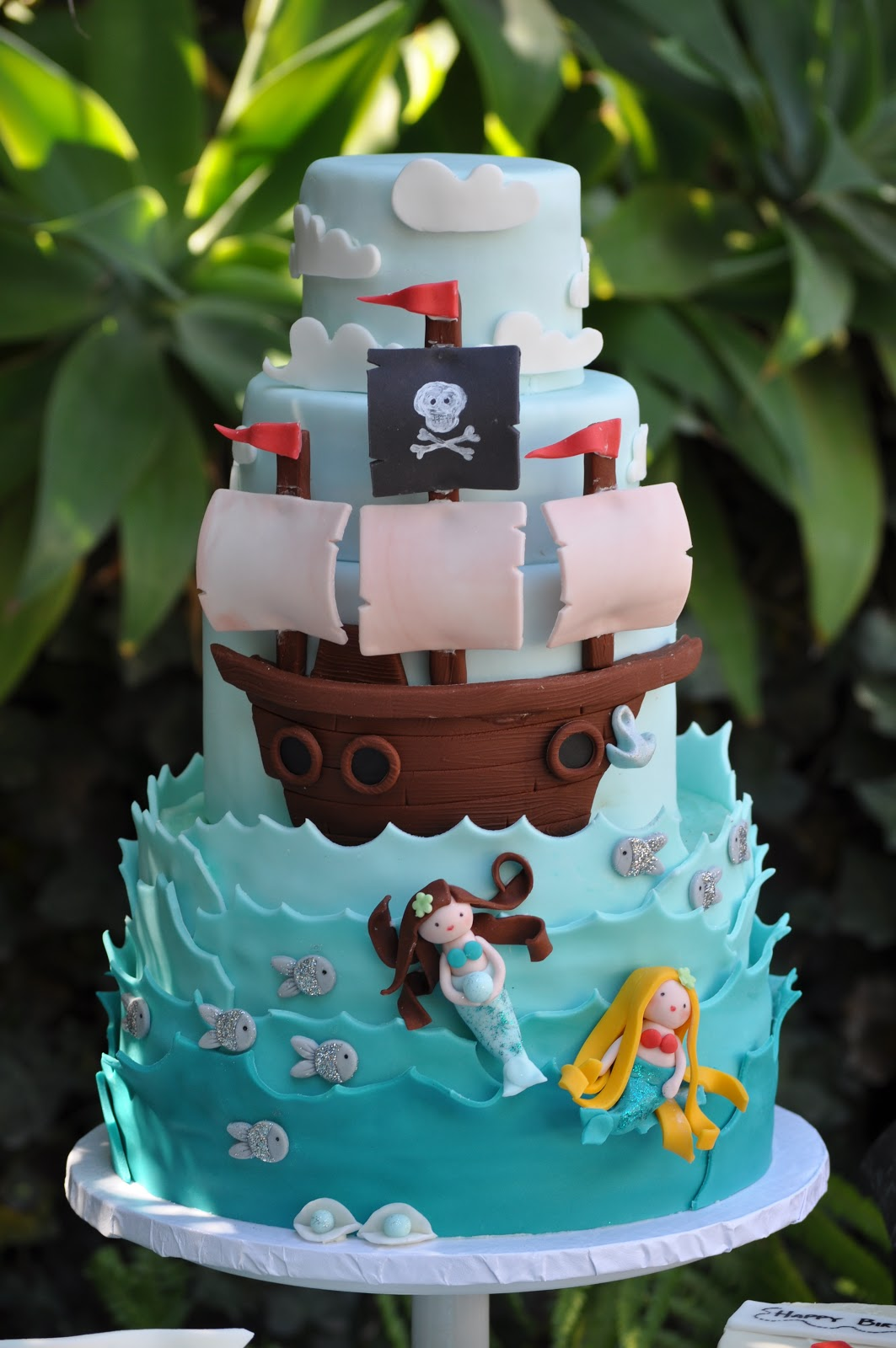 a pirate and mermaid blue cupcake