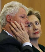 Bill and Hillary Clinton sitting in court