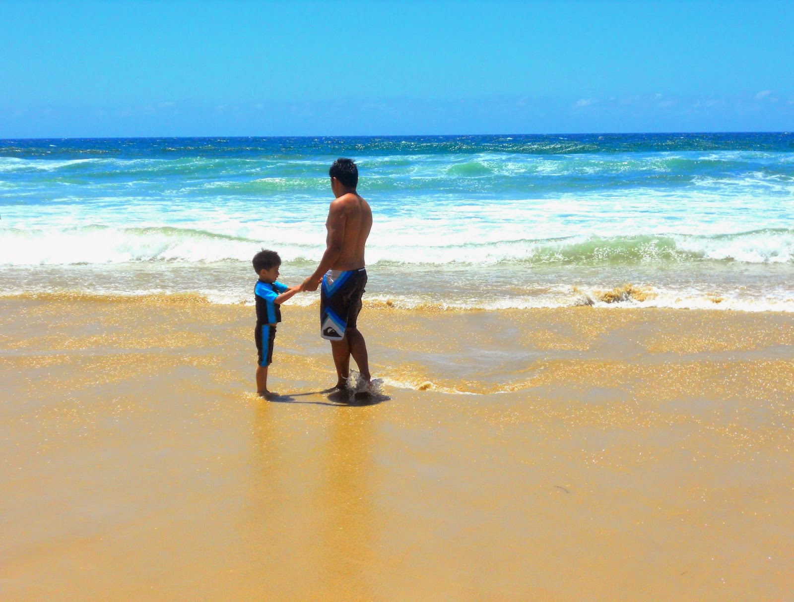 father and son, beach